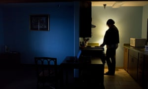 Heidi Ross stands in the kitchen of her room at a transitional housing facility in Anchorage where she has lived for the past three months.