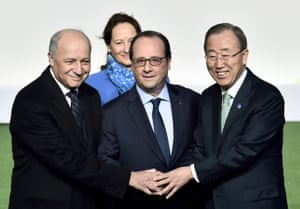 French president Francois Hollande, centre, with UN secretary general Bank Ki-moon, right, along with French foreign affairs minister Laurent Fabius, left, and Segolene Royal, minister for ecology, sustainable development and energy, wait for arrivals at the COP21, UN climate change conference, in Le Bourget, Paris