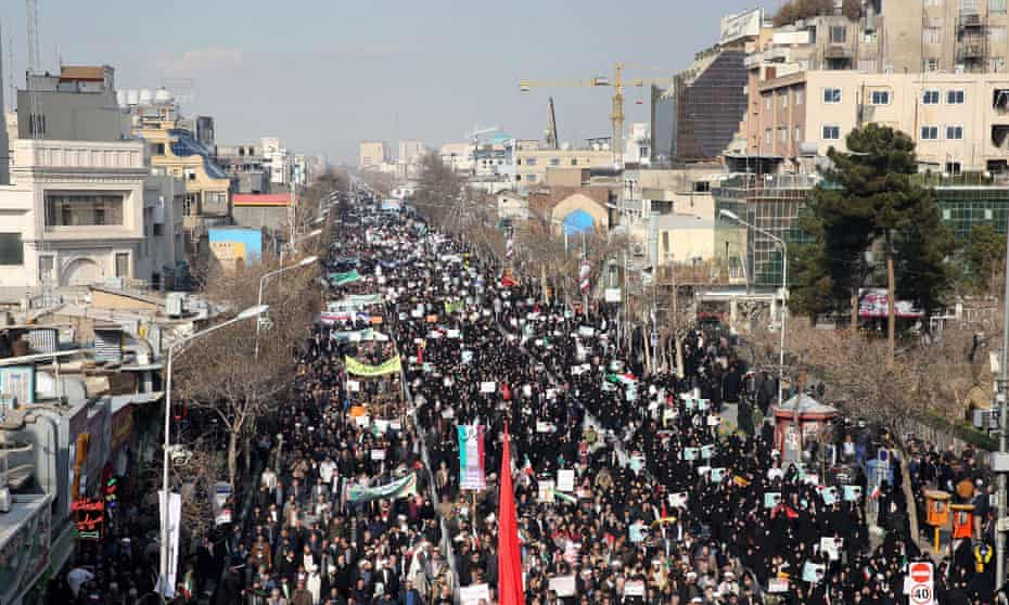 Iranian pro-government supporters march in Mashhad