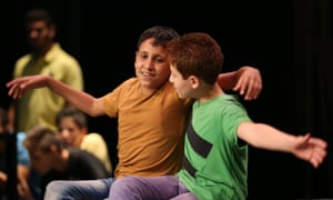 Ibrahim, 14, who plays the Artful Dodger, left, rehearses a scene with Fadi, 13, who plays Oliver.
