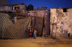 Gaza City Palestinian refugee children play outside of their family house during a power outage at al Shateaa refugee camp. The 1.8 million people who reside in Gaza, experience some 20 electricity outages per day