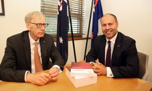 Commissioner Kenneth Hayne hands treasurer Josh Frydenberg the banking royal commission's final report at Parliament House in February 2019