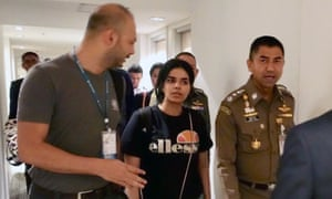Saudi teenager Rahaf Mohammed al-Qunun (middle) barricaded herself in a Bangkok airport hotel room on Sunday to prevent being deported. On Wednesday the UN found her to be a refugee.