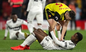 Craig Cathcart of Watford consoles Ryan Sessegnon after Fulham's relegation was confirmed.