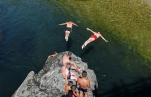 Skopje, Macedonia Young men dive into the river Treska near Skopje