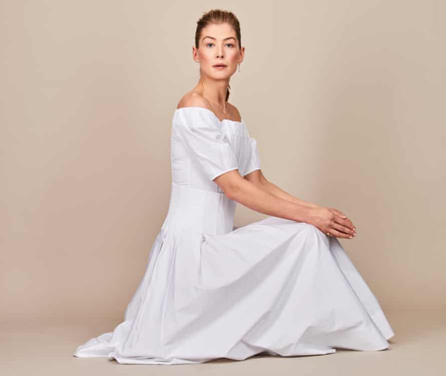 Rosamund Pike wears a white dress