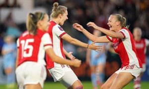 Arsenal's Vivianne Miedema (centre) celebrates scoring their side's first goal.
