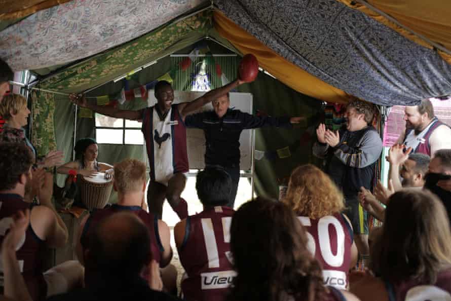 A football team inside a tent
