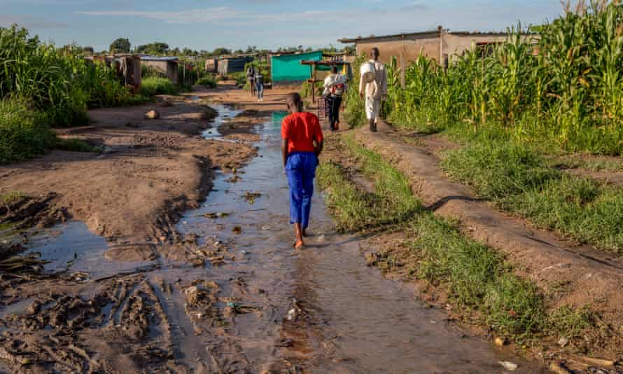 A dirt road in a shanty town outside Zimbabwe's capital, Harare. Years of high youth unemployment has seen more young people turn to drugs such as crystal meth.