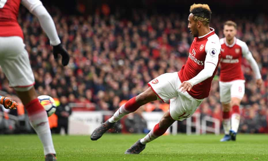 Pierre-Emerick Aubameyang volleys a shot into the corner for his and Arsenal's second goal.