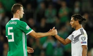 Serge Gnabry shakes hands with Jonny Evans at the end of the match.