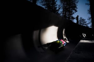Slovenia's luge athletes Lovro Kovacic and Tian Badzukov compete in the women's doubles competition at the St Moritz natural luge track.