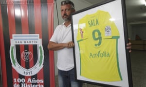 Daniel Rivero, a director at the football club where Emiliano Sala played as a child, holds aloft a Nantes shirt given to San Martín by the missing player.