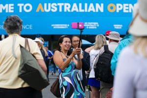 Tennis fans take selfies at the entrance.