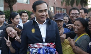 Thai prime minister Prayuth Chan-ocha, center, talks with supporters in Nakhon Ratchasima, Thailand.