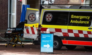 A coronavirus sign in front of an ambulance at royal prince alfred hospistal