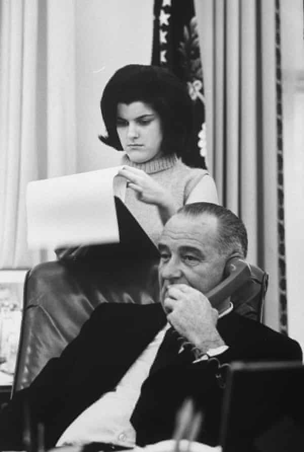 Lyndon Johnson with his daughter Luci at the White House.