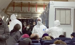 Image from a video taken on 17 February shows American passengers who were evacuated from the Diamond Princess cruise ship on a plane bound for the US.