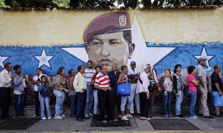 Venezuelans wait to vote in a poll called 'popular consultation' in Caracas, Venezuela, on 16 July 2017.