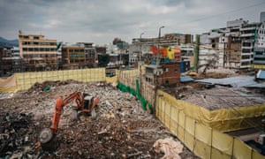 Excavators dig out debris of demolished buildings, Euljiro, Seoul.