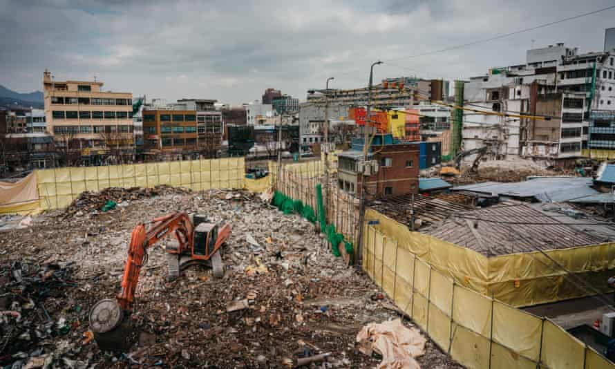 Excavators dig out debris of demolished buildings, Euljiro, Seoul.