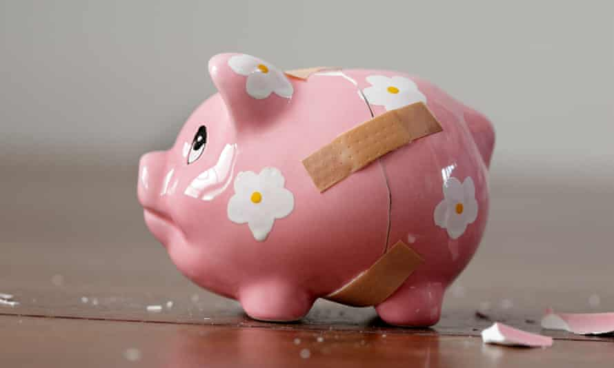 A broken piggy bank with bandages on it