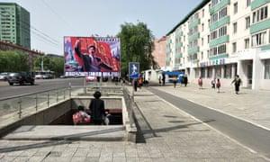 Propaganda above a road underpass in Ryonghung, Pyongyang