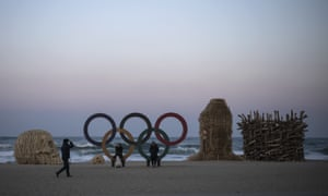 The Olympic rings and art installations on a beach in Gangneung.