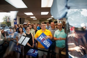 Supporters watch Joe Biden deliver remarks in his campaign office in Iowa City, Iowa, on 7 August 2019.