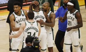 Milwaukee Bucks players celebrate after defeating the Phoenix Suns in Game 5 of the NBA finals