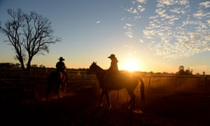 Jack Southern, 12, and his 10 year-old sister Kate ride their horses at the family's cattle and sheep property near St George in south-western Queensland. AAP Image/Dan Peled