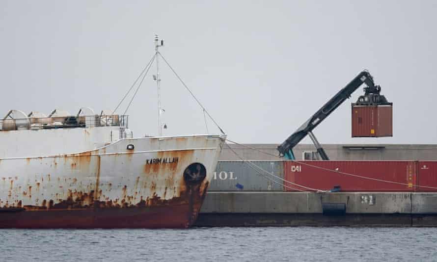 A crane moves a container next to livestock ship Karim Allah at Escombreras port in Cartagena, Spain, on 27 February.