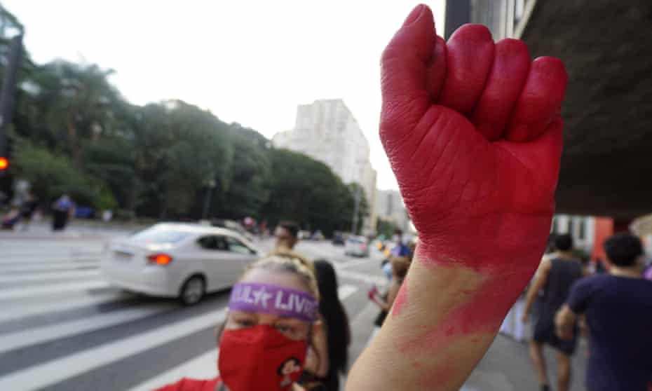 Woman with hand painted red takes part in International Women's Day protests in Sao Paulo in March.