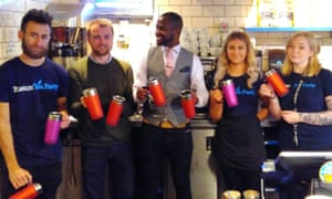 Austin Cohen (centre) with people in the Boston Tea Party cafe holding mugs which are being handed out to those who are street homeless in Salisbury