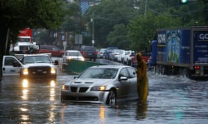 A man checks on a stranded vehicle in Philadelphia on Tuesday.