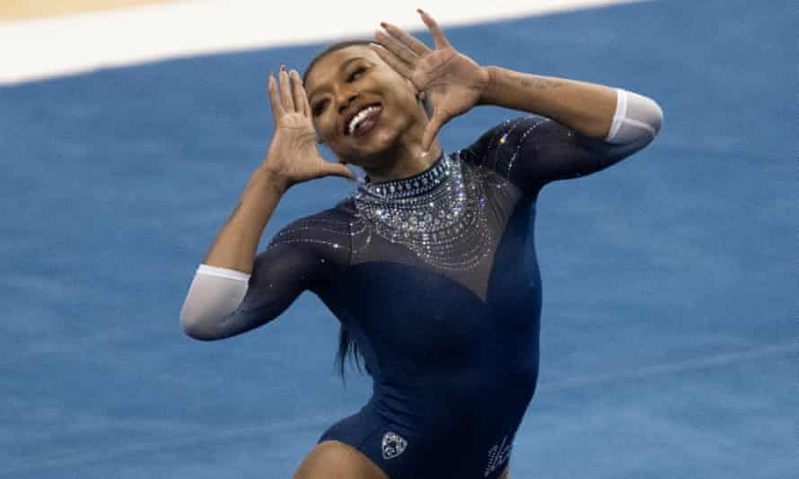 Nia Dennis competes on the floor during an NCAA gymnastics meet against Arizona State, a performance which went viral