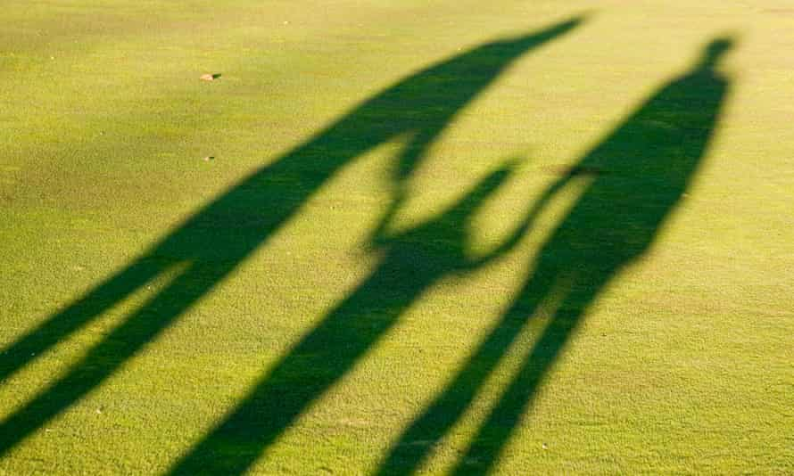 Shadows of parents and child