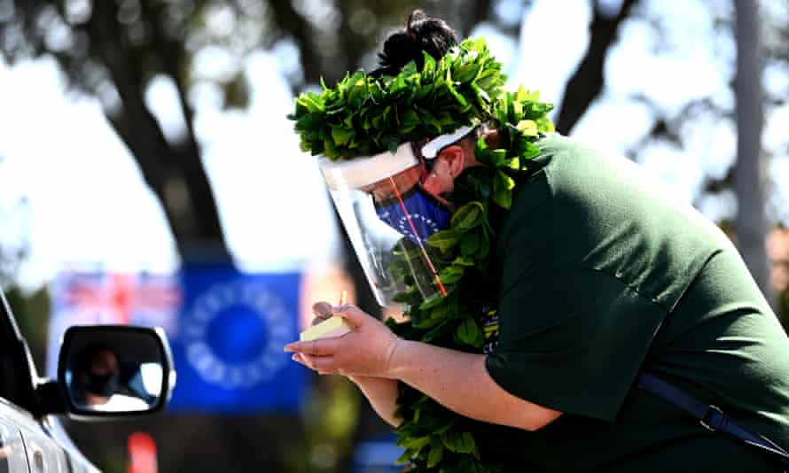 A volunteer at a Cook Islands drive through vaccination community event in Auckland, New Zealand