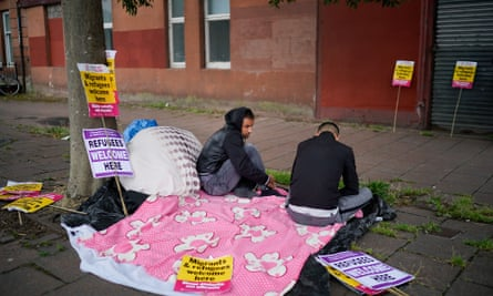 Two Serco tenants protest outside the Home Office in Glasgow in August 2018.