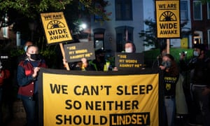 Protesters gather outside the residence of Senator Lindsey Graham, in Washington.
