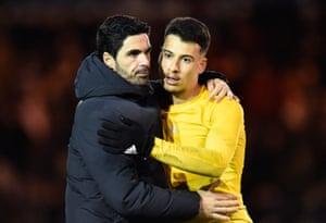 Arsenal manager Mikel Arteta hugs Gabriel Martinelli.
