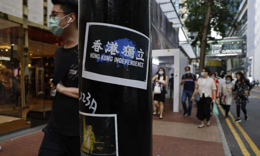 Stickers with messages of the pro-democracy movement are left by protesters on a street in Hong Kong.