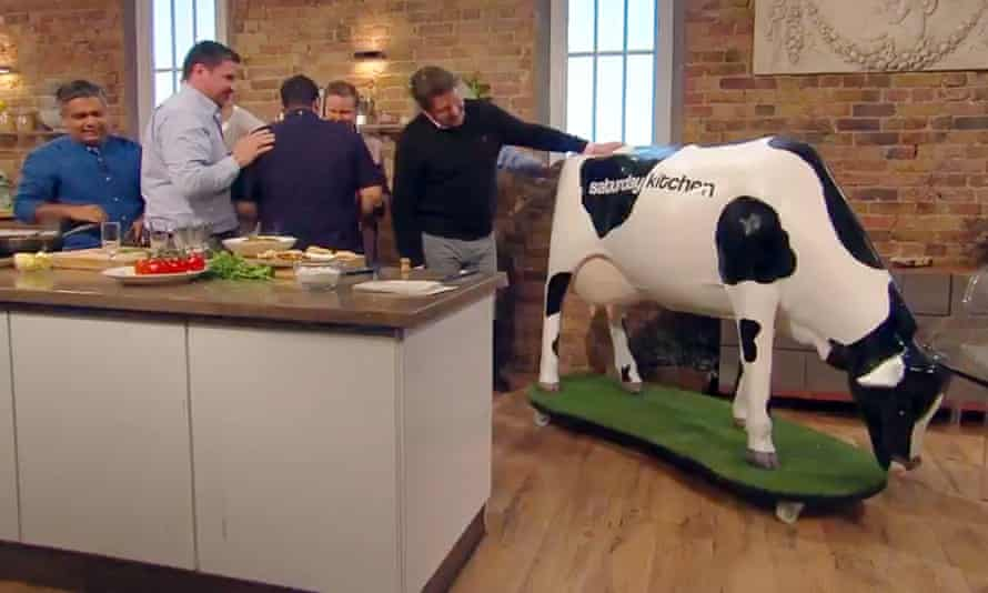 Martin received a near-lifesize statue of a Friesian cow.