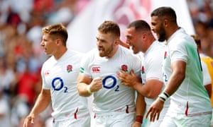 Luke Cowan-Dickie celebrates after scoring England's third try late in the first half.