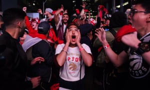Fans react outside Scotiabank Arena as the Raptors clinch the NBA title