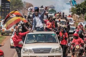 Bobi Wine greets supporters near Kayunga, Uganda, 1 December