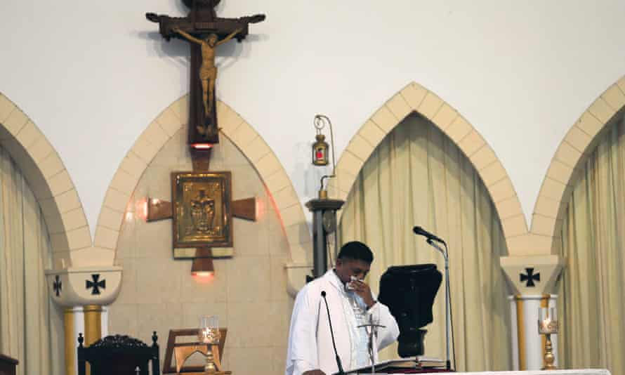 A priest gives an emotional address to worshippers at St Theresa's church in Colombo, Sri Lanka
