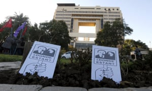"""Two posters with images of people who disappeared during the  Pinochet dictatorship with the words """"Where are they?"""" are seen in front of the congress building"""