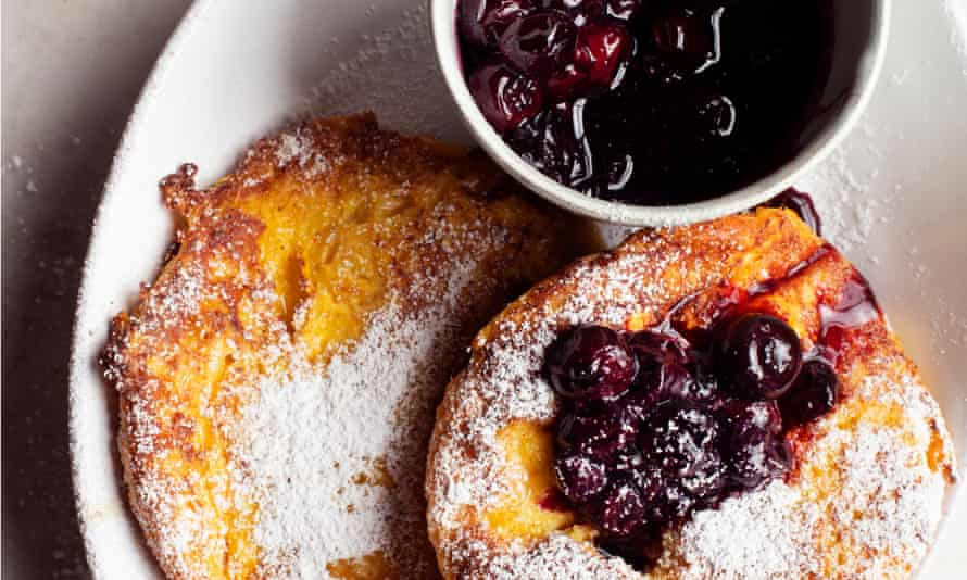French toast with blueberries and maple syrup.