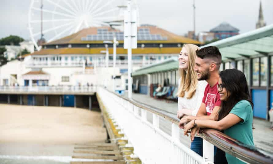 Group of students standing on Bournemouth Pier, just a short walk away from Lansdowne Campus at Bournemouth University